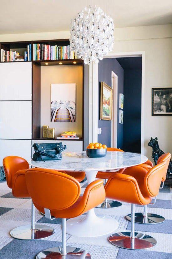 Orange Paulin chairs and Saarinen table