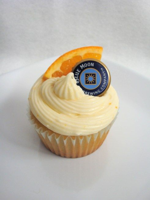 Blue Moon cupcakes with orange frosting. What a creative decorating idea!