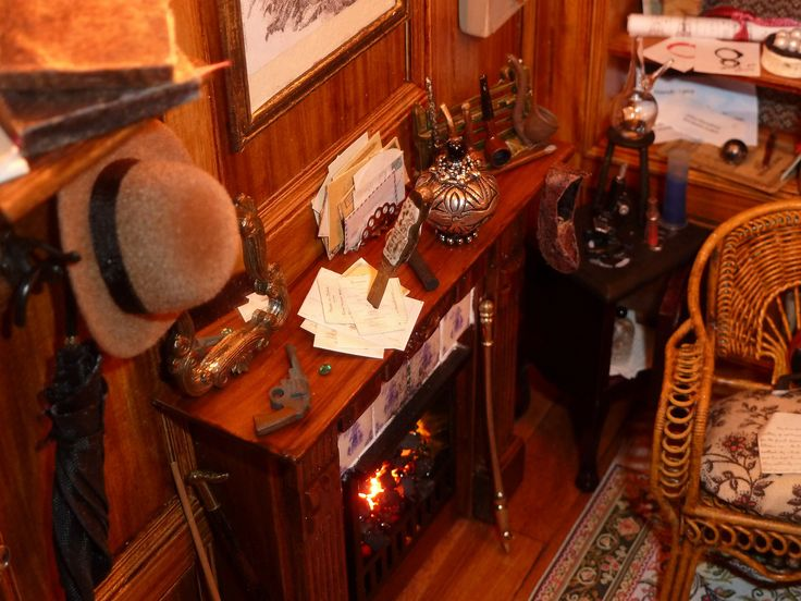 "https://flic.kr/p/gVutac | Sherlock's fireplace mantel... | ...a mirror (in the Jeremy Brett series always on the mantel)...Watson's gun, the emerald tie pin from Queen Victoria, correspondence held by a knife, his pipes and the Persian slipper with tobacco...also the bent fireplace poker from ""The Speckled Band""..."