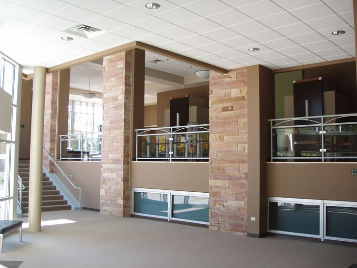 The Bridge Community Church – Des Plaines, IL. Warm, comfortable atmosphere to encourage church fellowship and welcome visitors. #Open #Renovation #NaturalDaylight #Windows #Glass #Mezzanine #GlassRailing #Warm #Inviting #Stone