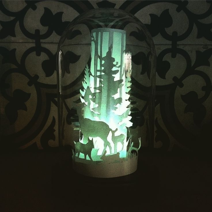Paper Cut winter scene under glass dome