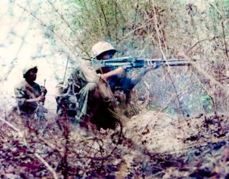 Machine Gunner firing a M60 machine gun. Current Machine Gun in that era.