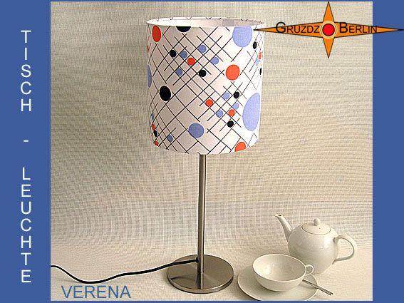 Tischleuchte VERENA Ø 20 cm Tischlampe Punkte. Einmal mehr eine Leuchte aus einem interessanten Designerstoff der 70er Jahre in der Leuchtenkollektion von Gruzdz-Berlin: Die Tischleuchte VERENA ist origninalem Retrostoff der 70er Jahre mit einer besonderen Punkte Grafik. Die Leuchte erzeugt so eine sachliche und doch verspielte Atmoshäre im Raum.