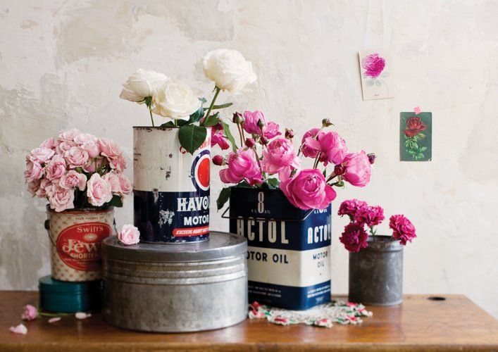 Flowers in motor oil cans.