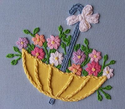 Eglantine Stitchery: Floral Umbrella, has some wonderful tips on the stitches used
