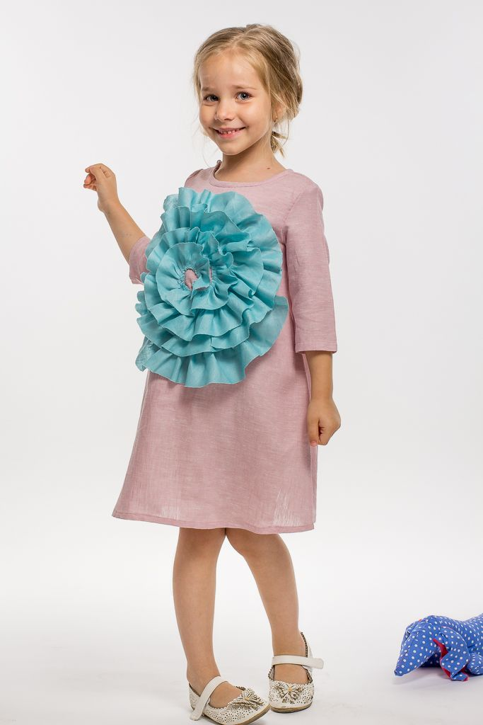 A magic summer dress in linen and with a giant tower application for your little girl amusement and for the smiles of those around. from Designers for kids with love