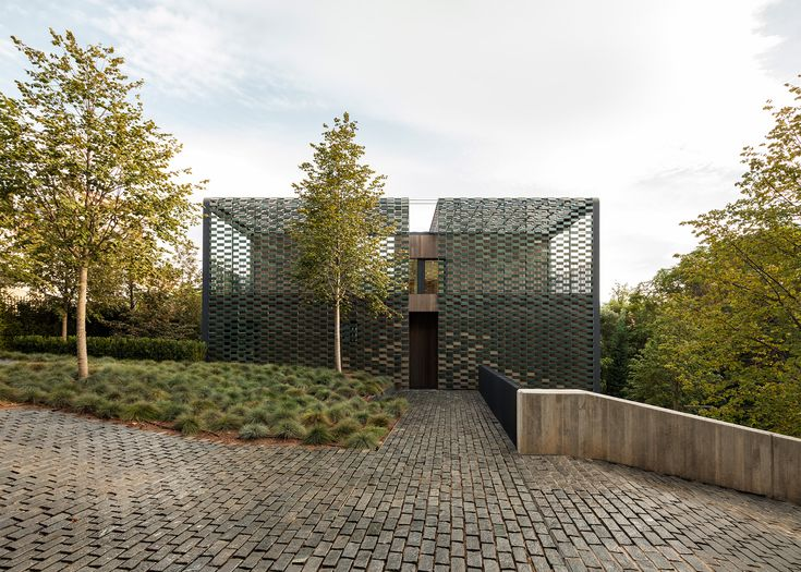 See-through camouflage of green tiles wraps Barcelona House by PMMT