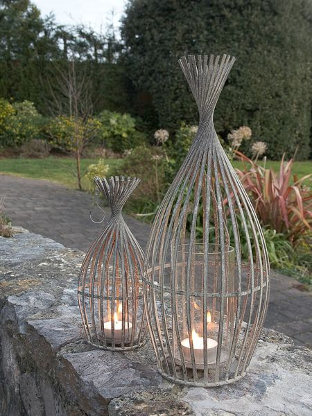 We love these fabulous lamps, which remind us of bundles of willow. . Magical in groups to light a path or  patio, and sensational for evening dinner parties.