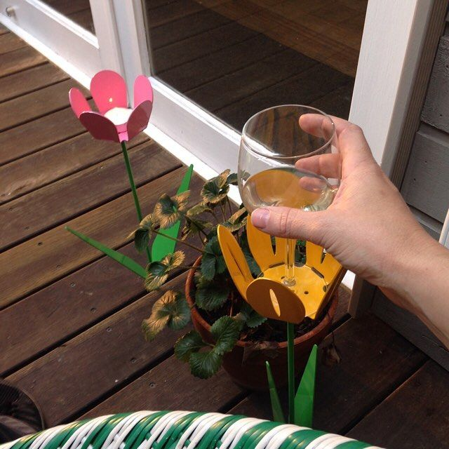 It's a night off.  #nightoff #evening #newmetalpetals #drinkholder #candleholder #bringalittlecolor #color #colorpop #metalpetals #deck #strawberry #wellearned #feetup #busynextweek #sleepintomorrow #nogoatforjack