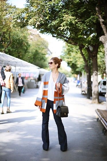 Get this look: http://lb.nu/look/7906300  More looks by A TRENDY  LIFE: http://lb.nu/atrendylife  Items in this look:  Bimba Y Lola Top, Primark Jeans, Vila Chaqueta, Chanel Bolso, A Trendy Life By Eguzkilore Colgante, Topshop Botines   #bohemian #casual #retro #seventies #kimonopunto #knitwear #flaredjeans #denim #chanelbag