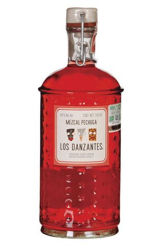 Mezcal Los Danzantes de Pechuga: This mezcal has an #interesting #distillation method: it's triple distilled in #copper stills, the last of which uses a #recipe of fruit and spices. A final step is to 'ink' the spirit with #cochineal, which is why it's #red. #Citrus flavors with notes of #tamarind make it #one of the #most sought after mezcal. #mescal #luxury tequila #tequila #spirits