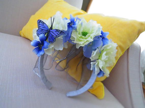 Bridal shower? Bachelorette? Wedding? Just because?This crown of flowers fascinator will be the perfect accessory, no matter the occasion! A grey headband and veil perfectly compliment the soft blue and cream tones of the flowers, while the gems lining the veil bring a bit of sparkle to