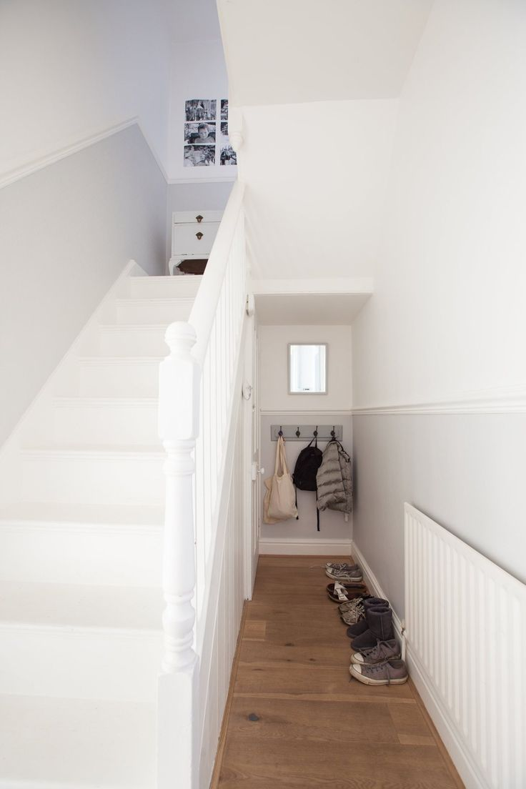 Coats and shoes at the end of the closed off hall. Bonnie & Russell's Scandi-Style Victorian
