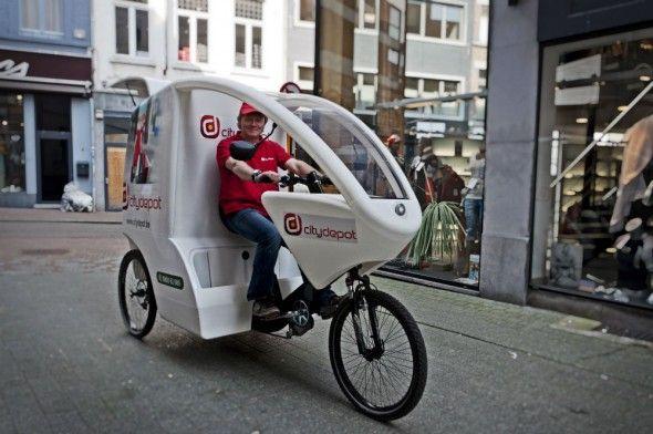 Citydepot | Leveranciers leveren goederen af aan de rand van de stad en de winkels worden bevoorraad op de fiets of met electrische stadsautootjes.