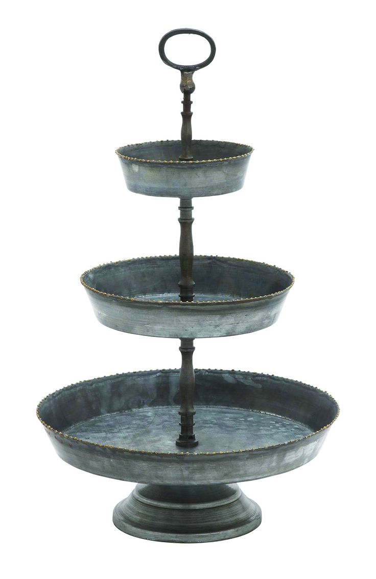 Features: - Three-tier Tray of dimensions: 13inx13inx22in - Made from 100 percent iron - Decorative serving dish Description: Add a vintage theme to your celebrative style with this three-tier marvelo