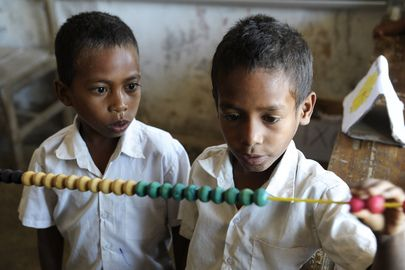 Secretary-General Ban Ki-moon visited the Cassait Primary School in the Liquica district of Timorese capital Dili. <br/><br/>Two boys engrossed in arithmetic in a classroom at the school.