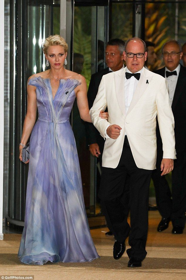 Glamorous:Wearing a stunning floor-length purple evening gown, the Zimbabwean-born former Olympic swimmer looked every inch the perfect princess