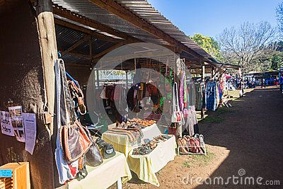 Farmers Flee Boot sale market with private products for sale to the public. Photo image of trading stores with people walking meeting talking looking around at Farmers market Hillcrest Highway area South-Africa