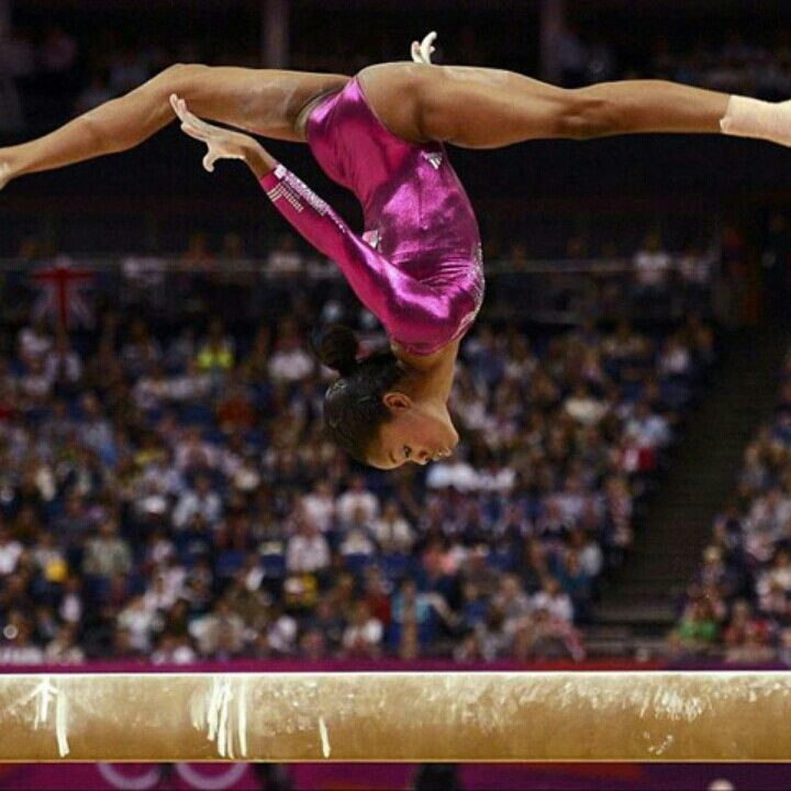 Gabby on beam doing a areal backwalkover