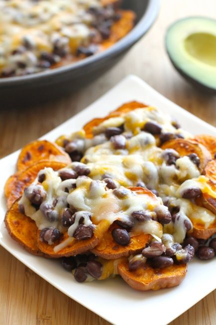 """Sweet Potato Nachos - I used chicken rather than black beans, and added avocado and salsa. So yummy, and the sweet potatoes have more nutrients than regular chips, so I guess these are """"healthy""""!!"""