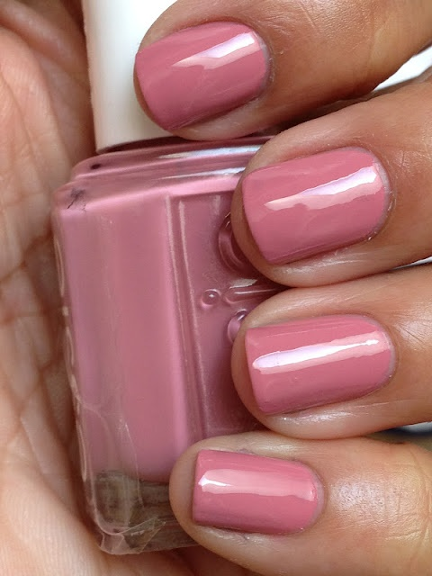 """Essie Marathin is described as """"a fit, rosy pink"""". Marathin is a slightly dusky, yet cool rose creme. Also, covered nicely with two coats."""