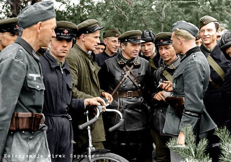 On September 17, 1939, 30 divisions of the Red Army crossed the Polish border.  September 22, 1939. Brest-Litovsk, Poland (now Belarus) Wehrmacht Soldiers fraternise with officers of the Soviet 29th Army Brigade.  (Photo source - Bundesarchiv, Bild 101I-121-0008-25)  (Color by Mirek Szponar)