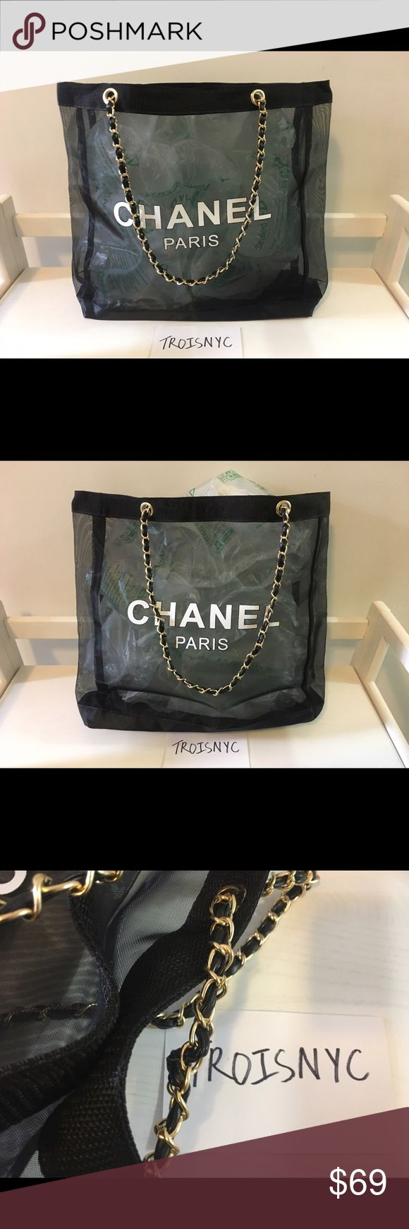 """New Authentic Chanel Large Black Tote Bag VIP Gift This new and authentic large black logo Chanel Tote bag has """"Chanel Paris"""" on the front and back of the bag. It has a leather like chain strap and a magnetic top closure. Measurements: 14"""" length x 13 3/4"""" height x 4"""" depth. CHANEL Bags Totes"""