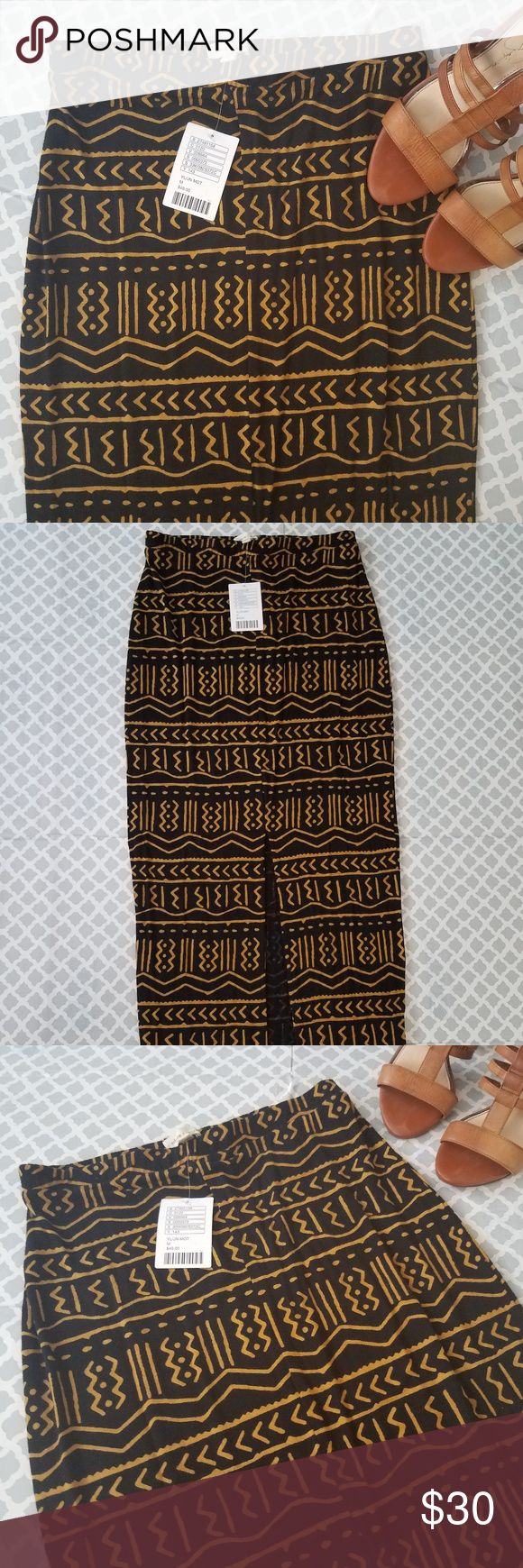 NWT Silence + Noise Black Tribal Maxi Skirt Silence & Noise sold at Urban Outfitters Size M New WIth Tags In perfect condition Maxi style skirt with a center slit silence + noise Skirts Maxi