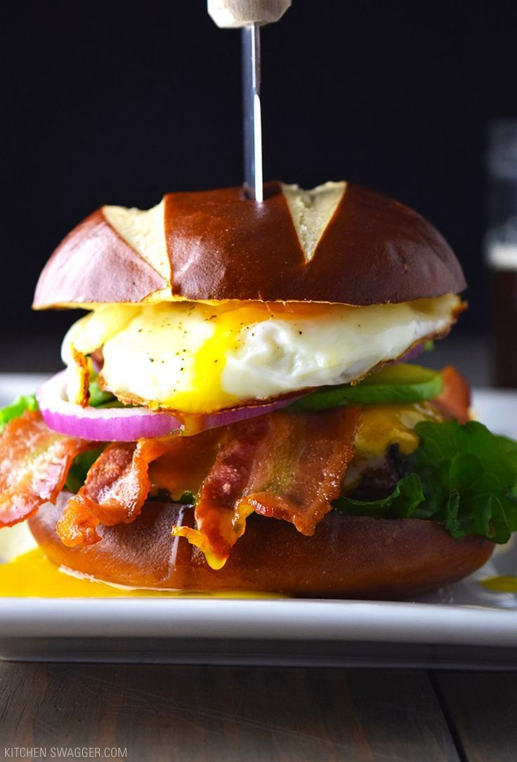 Bacon, Egg, and Avocado Cheese Burger on a Pretzel Bun