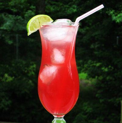 Mountain Breeze ~ 5 oz Vodka, .5 oz. Gin, .5 oz Rum, .5 oz. Triple Sec, .5 oz. Tequila, 1.5 oz. Sweet & Sour Mix, 1.5 oz. Cranberry Juice, 1 oz. Grapefruit Juice Lime wedge for garnish