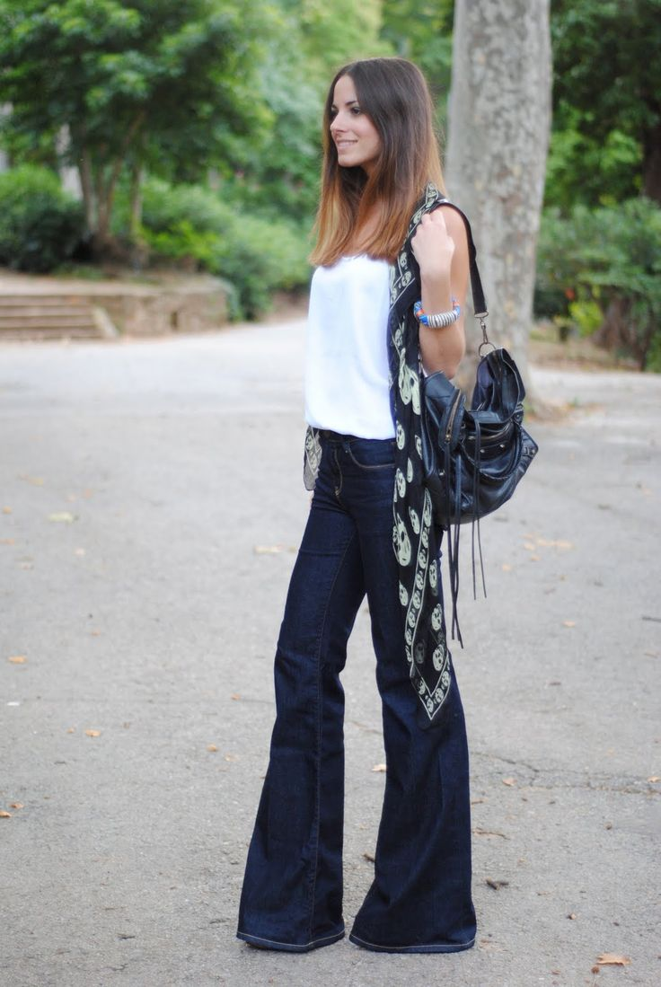 Wide leg, perfectly hemmed jeans look great with a white tee and skull scarf. - don't like the skull scarf, but any other scarf would look cute