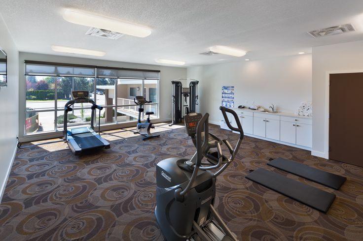 A fitness room with a view at the Kelowna Inn and Suites hotel, Kelowna, BC.