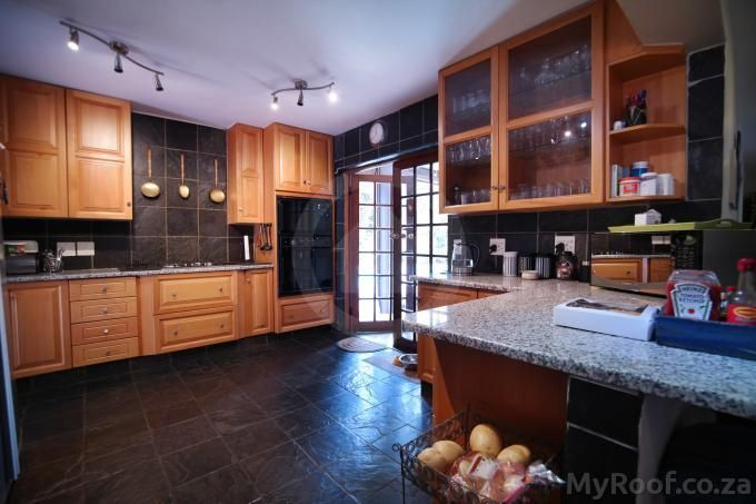 Beautiful wooden and slate finishes seen in exclusive estates at myroof.co.za