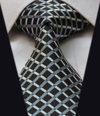 "Product number: GEO-2027 Length: 59"" Width: 3.25"" Material: 100% Silk Care: Dry Clean Only Label: GENTLEMAN JOE This simple, yet classy, silver and black necktie will give you confidence and style. An"