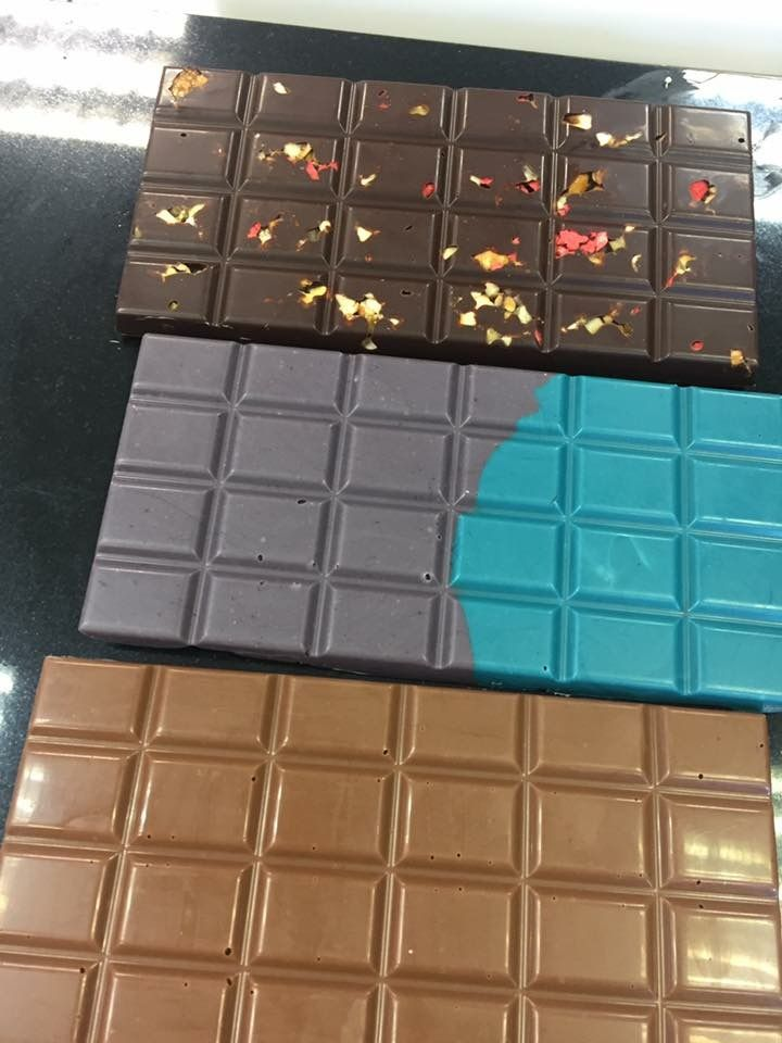 Chocolate bars made at chocolate school with mark tilling, couverture Belgium chocolate, 2 tone white chocolate and dark chocolate with strawberries and salted caramel pieces