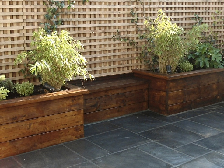 15 best images about stone in the garden on pinterest for Wooden flower bed ideas