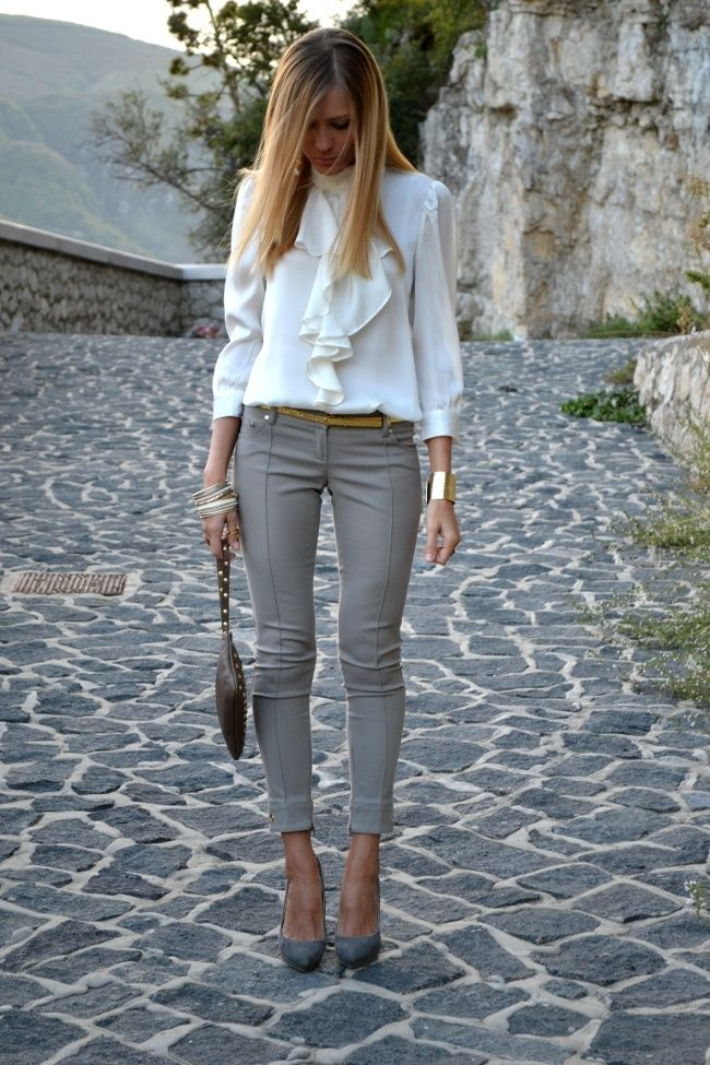 White ruffle top, gray skinny crop pants, gray pumps, gold cuff bracelet