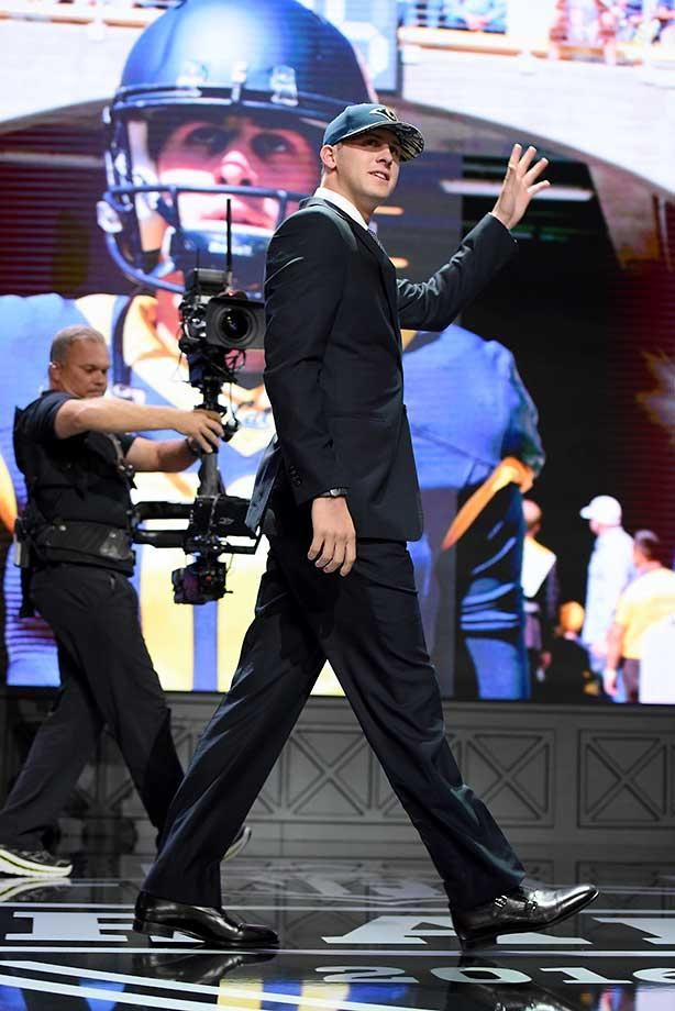California's Jared Goff walks on stage after being drafted first by the L.A. Rams.