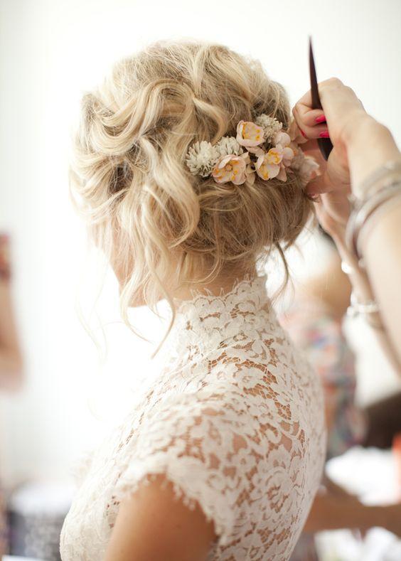 messy wedding hairstyle updo with flowers - Deer Pearl Flowers / http://www.deerpearlflowers.com/wedding-hairstyle-inspiration/messy-wedding-hairstyle-updo-with-flowers/