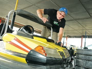 Barrie Fair starts today  - Greg Wells was busy making sure the scooter cars were spotless for he arrival of carnival goers.