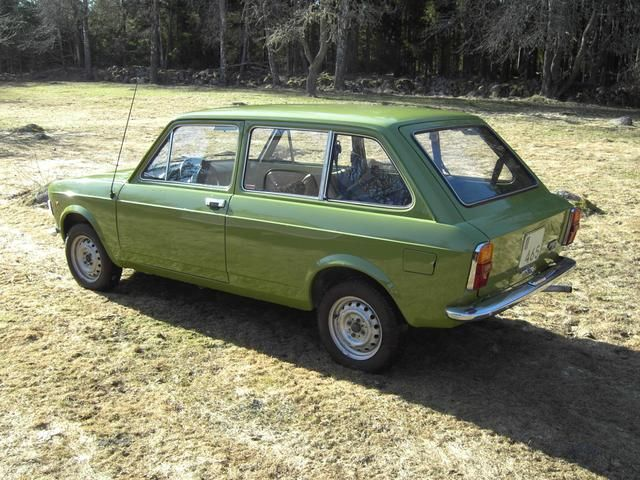 Fiat 128 1100 estate/wagon. I had one of these in this colour, 1975 model I think. Strange car! - had a hand throttle, precursor to Cruise control but dangerous. It rusted from the top down, tops of the doors rusty, bottom perfect. Rear interior trims were the same as in the 4 door like they had just welded the doors shut. Went very well except when the front bakes seized on - a regular occurrence.