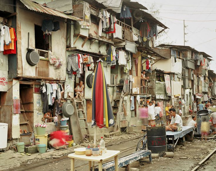 """""""Peter Bialobrzeski has been traveling across Asia (and some other countries) for many years now, taking photographs of countries in transition.""""  http://jmcolberg.com/weblog/2012/01/review_the_raw_and_the_cooked_by_peter_bialobrzeski/"""