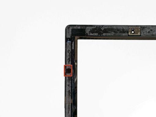 Schritt 5 -       Im iPad-Klebering in der oberen rechten Ecke des iPad (ca. 5 cm von der Oberseite des iPad), gibt es eine kleine Lücke. Verwenden Sie diese Lücke zu Ihrem Vorteil.      Drücken Sie die Spitze eines Kunststoff-Öffnungswerkzeugs in die Lücke zwischen dem Kunststoffrahmen und der Frontscheibe. Achten Sie darauf, nur die Spitze einzufügen - genug, um die Lücke zu erweitern.
