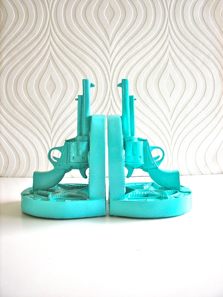 Annie Git Yer Books 'n Guns!  For those Mounted Shooting Cowgirls on your Xmas List.... Set of 2 Gun Bookends in aqua. $26.00, via Etsy.