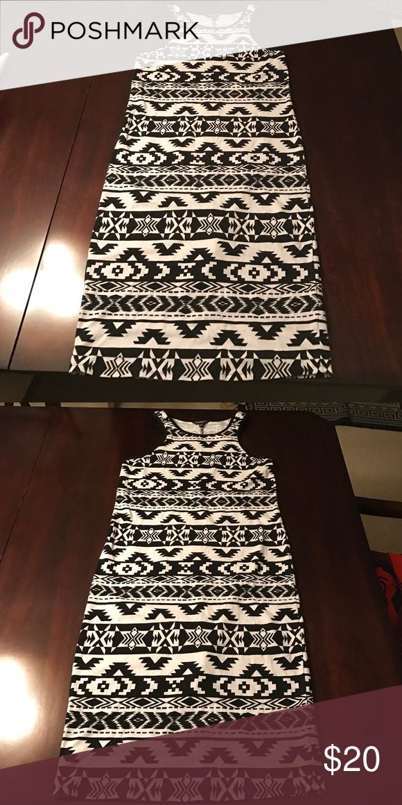 Black and white Aztec print midi The curve-hugging midi dress is fun for a night out on the town. Stretchy size Large Dresses Midi