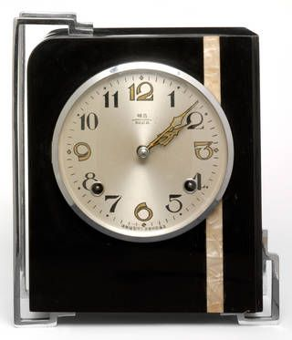 Clock, B.E. Co, about 1935, China. when the Europeans emigrated to the US and American designers travelled to Europe, the extensive American Art Deco scene emerged. US designers strove to 'Americanise' the aesthetic, adapting it with cheaper materials, machine production and American social habits. The most enduring of these adaptations was streamlining. Originally inspired by the speed and efficiency of machine-age travel, aerodynamic curves and economic lines weren't just applied to…