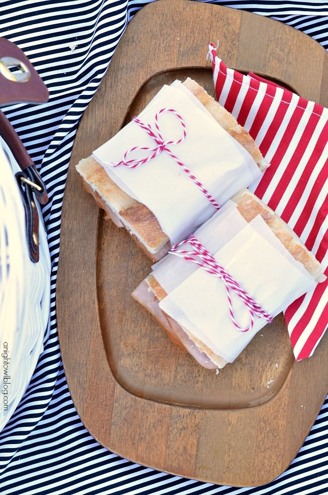Picnic Perfect: Picnic Ideas, Recipes and Tips - ham and swiss sandwiches. Sandwiches are easy picnic fare and wrapped in parchment and baker's twine – not only are they cute, they are easy to pack up and bring along!