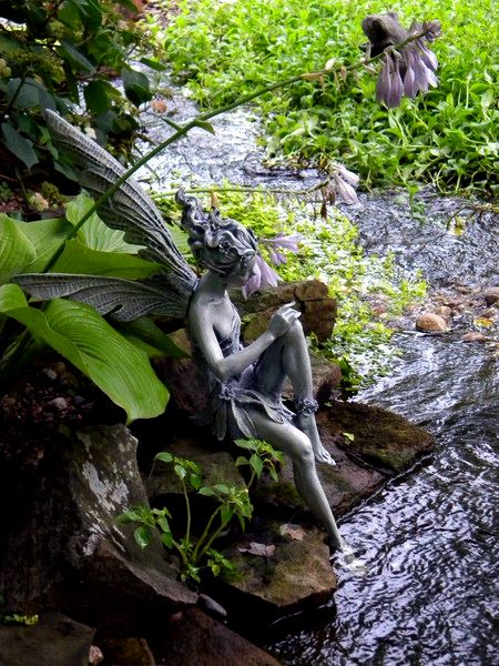 Fairy statue by the waterbank. Looks like Cairnglaze caverns in Cornwall- such a gorgeous place.