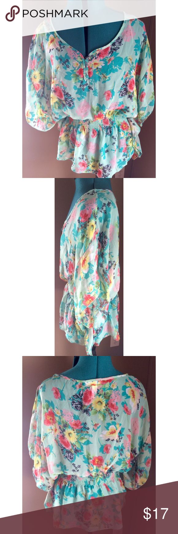 "Ambiance Apparel Sheer Boho Peasant Floral Top Pretty flirty floral sheer boho top from Ambiance Apparel Mint green and bright blue with multicolor flowers allover 3 small buttons up the front ruched waist and short flowing batwing sleeves Polyester Size Large - Pit to pit: 23"" ---- length: 27"" Good used condition - gently worn.  Free of rips, stains, odors. Ambiance Apparel Tops"