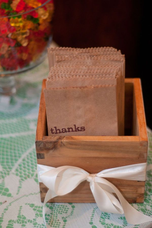 Cute Idea, Have a bar of snacks with thank you bags. Let the guest put together their own wedding favors to take home! Hmmmmm